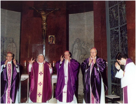 Father Frank Pavone, right, National Director of Priests for Life, concelebrates Mass at the Vatican with Pope John Paul II and several American archbishops.